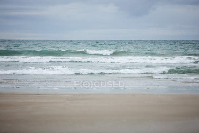 View of beach with waves — Stock Photo