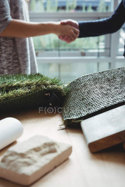 Artificial turf and stone slab on table in office — Stock Photo