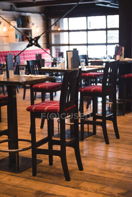Interior of empty rustic pub with chairs — Stock Photo