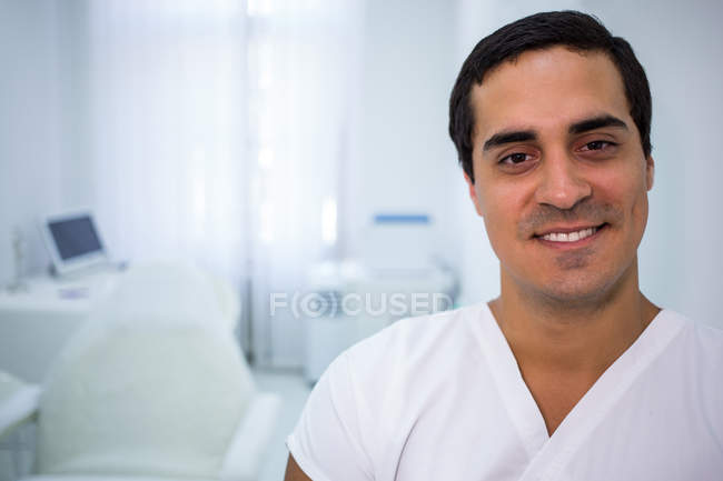 Portrait of smiling male doctor standing in clinic — Stock Photo
