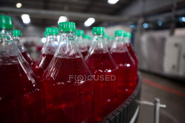 Cold drink bottles on production line at factory — Stock Photo