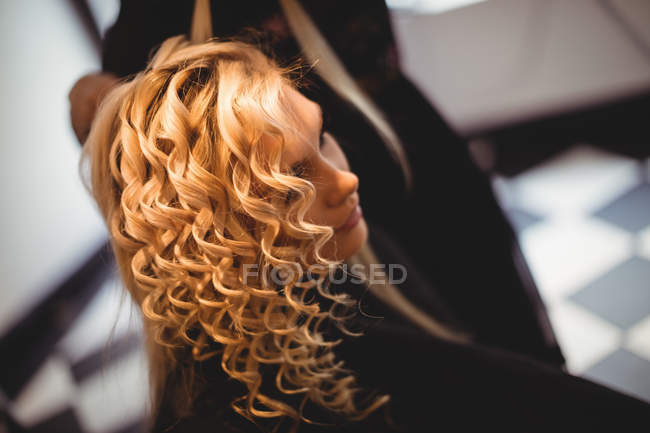 Close-up of woman in hair salon — Stock Photo