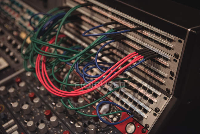 Close-up of audio cables connected to mixing console in recording studio — Stock Photo