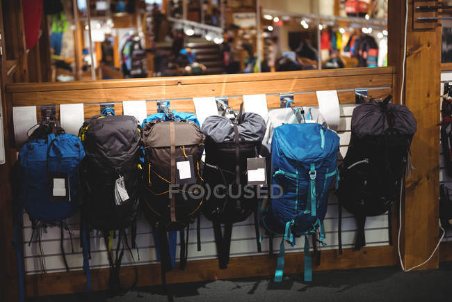 Variety of sports bags on rack in store — Stock Photo