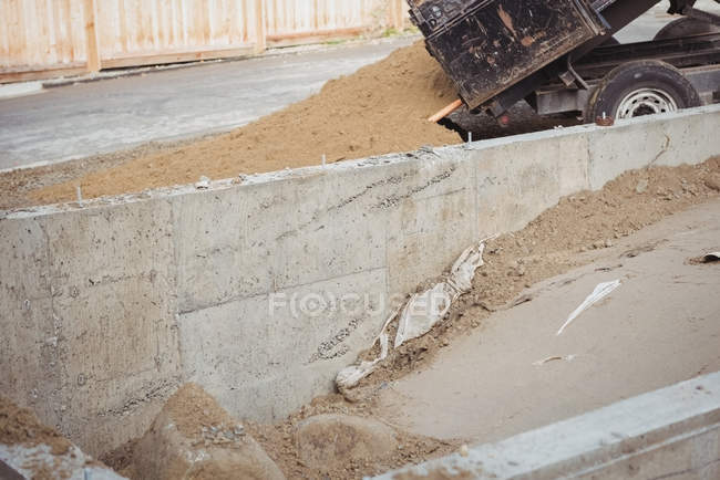Close-up of dumper unloading mud at construction site — Stock Photo