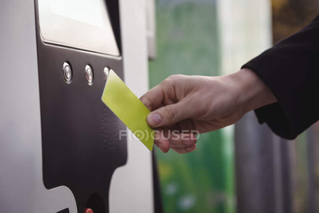Hand of man using card at electric vehicle charging station — Stock Photo