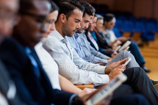 Business executives participating in a business meeting using digital tablet at conference center — Stock Photo