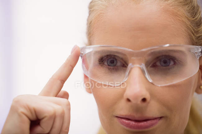 Close-up of female doctor wearing protective glasses in clinic — Stock Photo