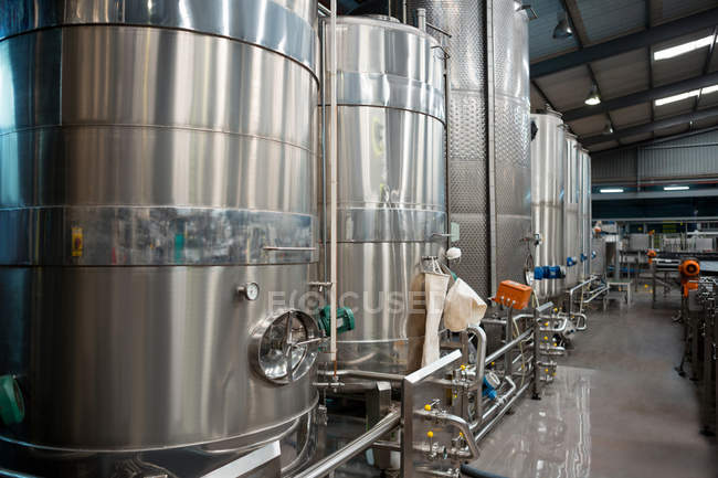 Storage tanks and machinery in juice factory — Stock Photo