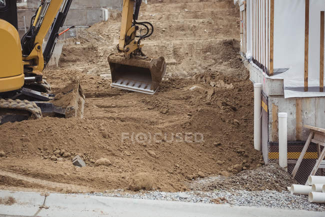 Bulldozer removing mud at construction site — Stock Photo