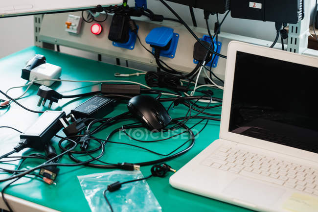 Laptop on table in a repair centre — Stock Photo