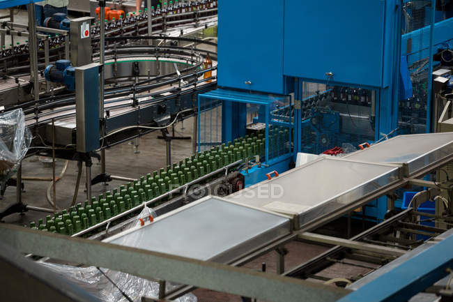 High angle view of machinery and production lines in juice factory — Stock Photo
