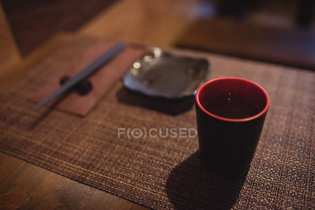 Cup of sake on dining table in restaurant — Stock Photo