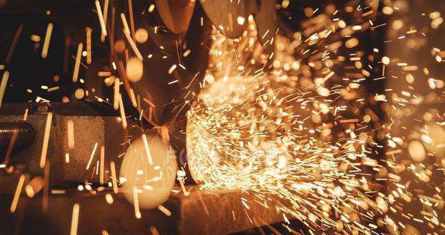 Close-up of welder welding a metal in workshop — Stock Photo
