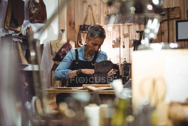 Attentive craftswoman working in workshop — Stock Photo