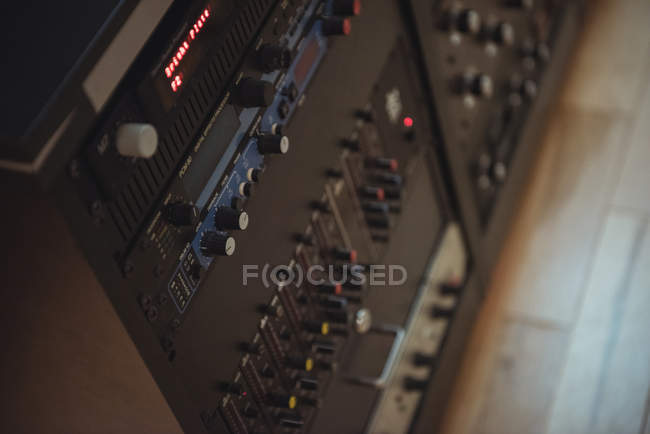 Close-up of control buttons on vintage sound mixer — Stock Photo