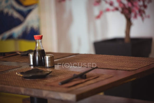 Salt and pepper shakers on dining table in restaurant — Stock Photo