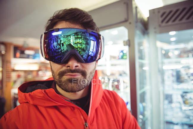 Close-up of handsome man in ski goggles — Stock Photo