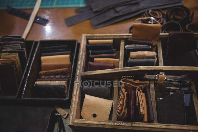 Various leather wallets in steel crate in workshop — Stock Photo