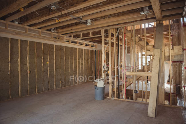 Timber and wall of a building under construction — Stock Photo