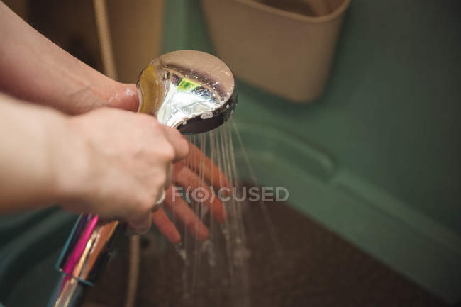 Close-up of woman washing hands after cleaning a dog in bathtub — Stock Photo