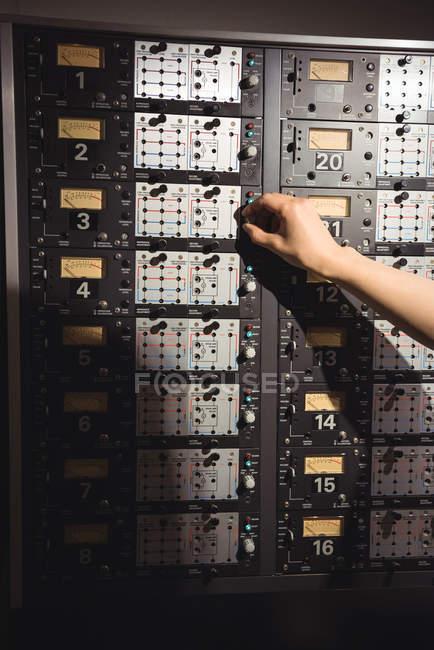 Audio engineer using track recorder in recording studio — Stock Photo