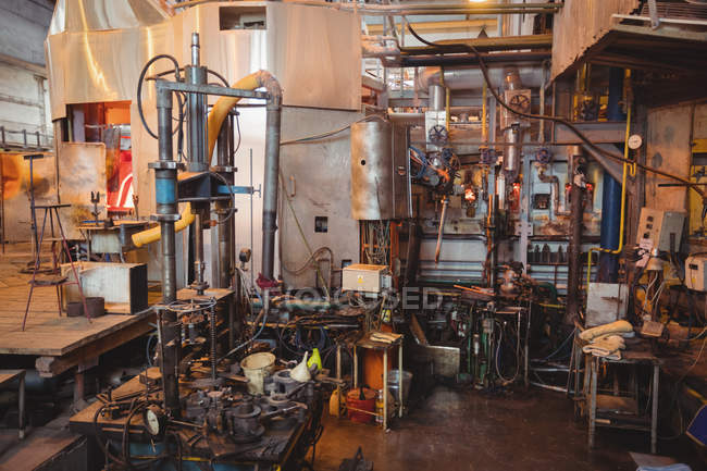 Empty workstation and machinery at glassblowing factory — Stock Photo