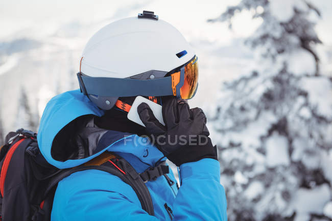 Close-up of skier talking on mobile phone — Stock Photo