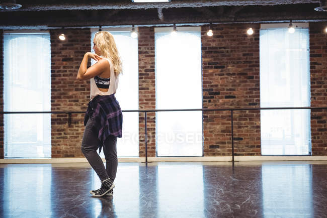 Woman practicing a dance move in dance studio — Stock Photo