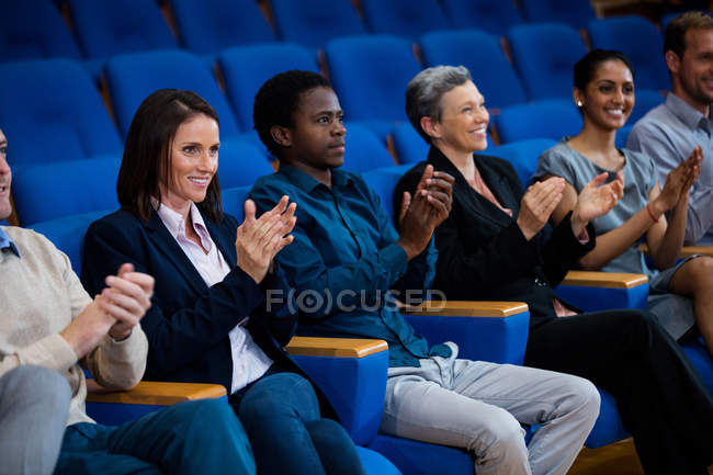 Business executives applauding in a business meeting at conference center — Stock Photo