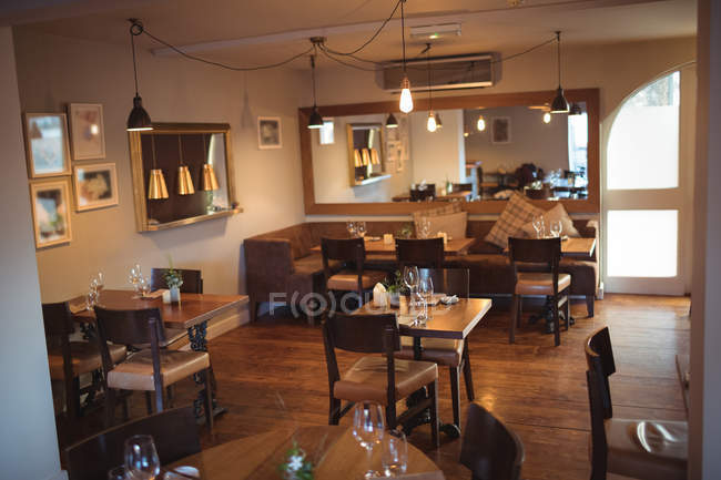 Tables And Chairs Arranged In Empty Modern Coffee Shop Nobody Sofa Stock Photo 225294060