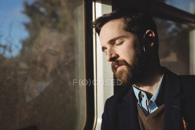 Businessman sleeping while travelling in train — Stock Photo