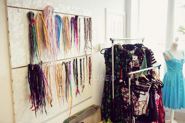Assorted colorful artificial dreadlocks in shop — Stock Photo