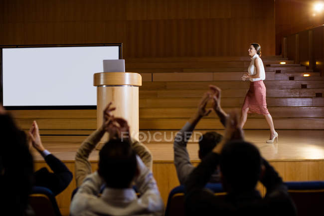 Audience applauding speaker before conference presentation at conference center — Stock Photo