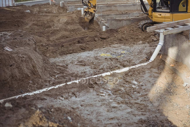 Drainage pipe under mud at construction site — Stock Photo