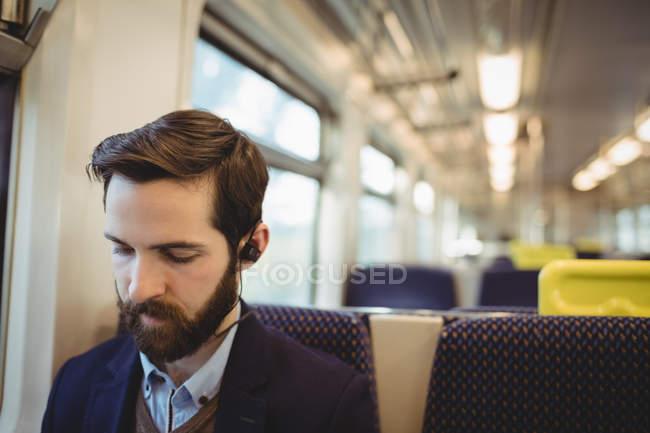 Young businessman travelling in train — Stock Photo