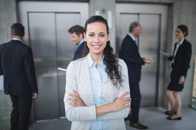 Portrait of a confident businesswoman smiling in office — Stock Photo