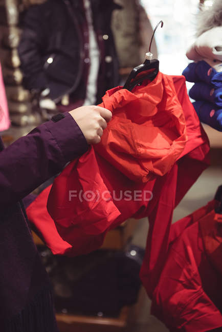 Close-up of woman shopping in a clothes shop — Stock Photo