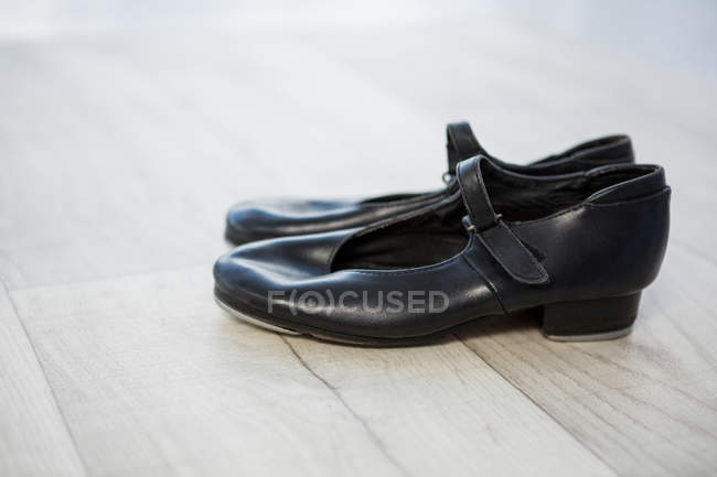 Close-up of tap shoes on wooden floor — Stock Photo