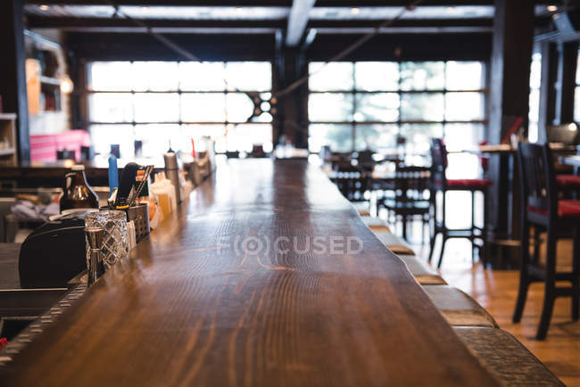 Interior of an empty bar with long table — Stock Photo
