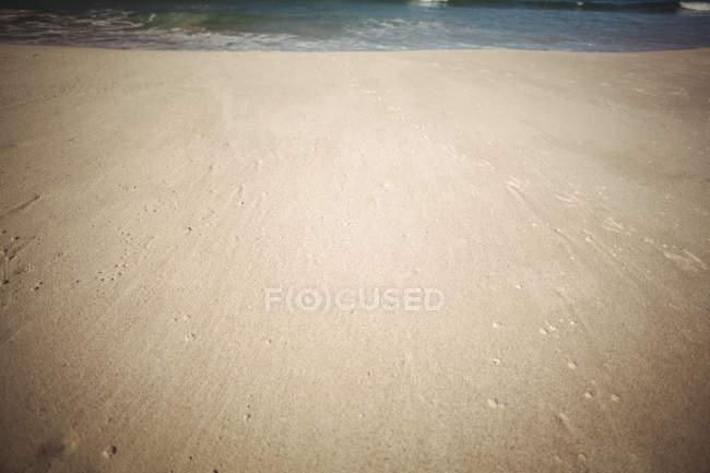 Close-up de superfície de areia na praia do mar — Fotografia de Stock