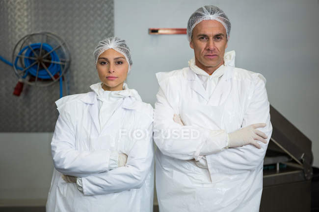 Portrait of two butchers standing with arms folded — Stock Photo