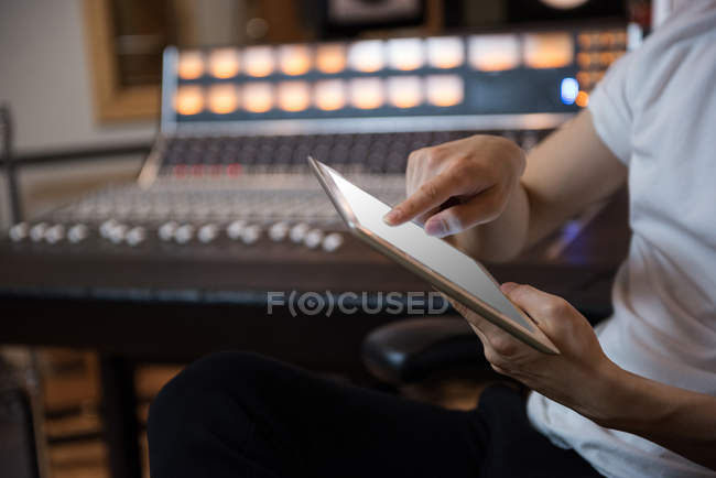 Hands of a person using digital tablet in recording studio — Stock Photo