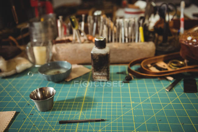Work tools on table in artisan workshop — Stock Photo