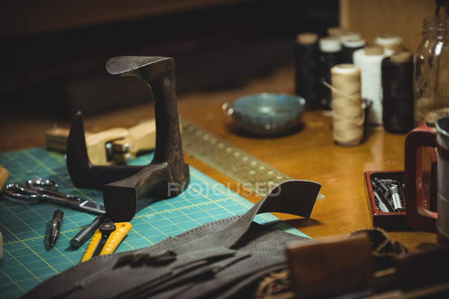 Various work tools on table in workshop — Stock Photo