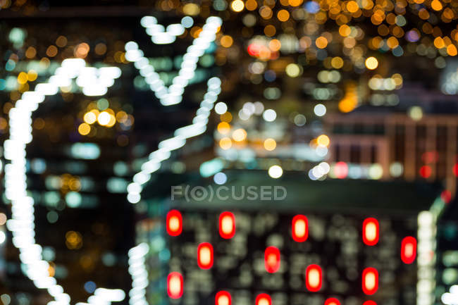 Abstract bokeh of busy city street at night — Stock Photo