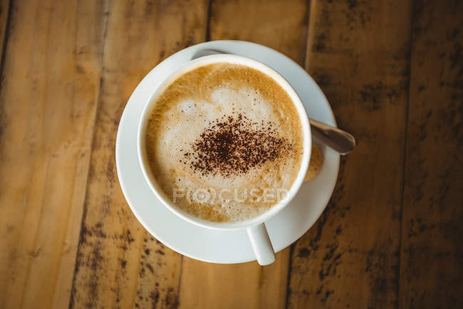 Coffee cup and saucer on a table in cafe — Stock Photo