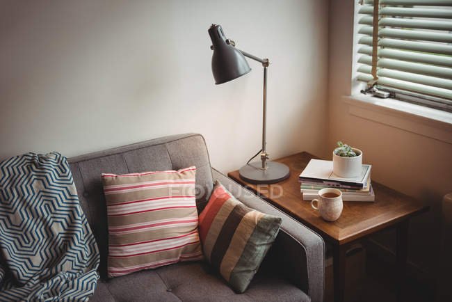 Sofa and table lamp in living room at home — Stock Photo