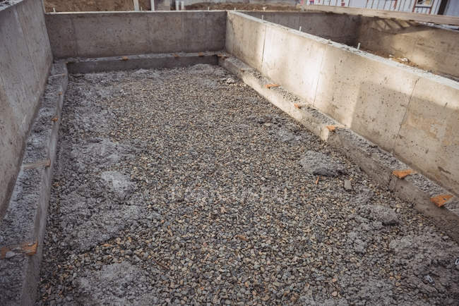 Concrete foundation with gravel at construction site — Stock Photo