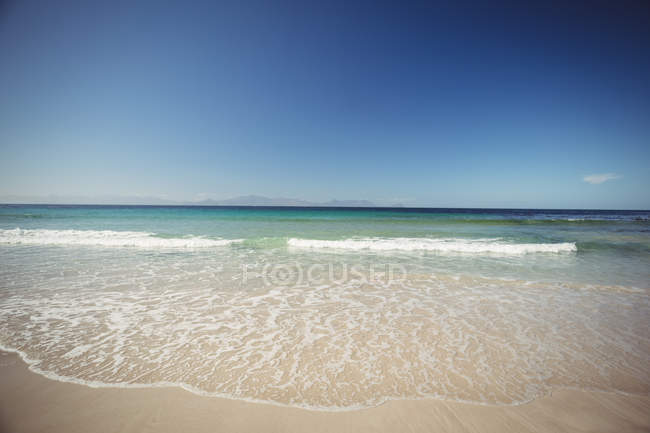 Majestic view of waves coming towards sandy beach — Stock Photo